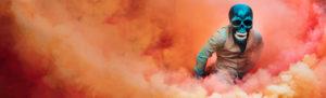 A man surrounded by orange smoke